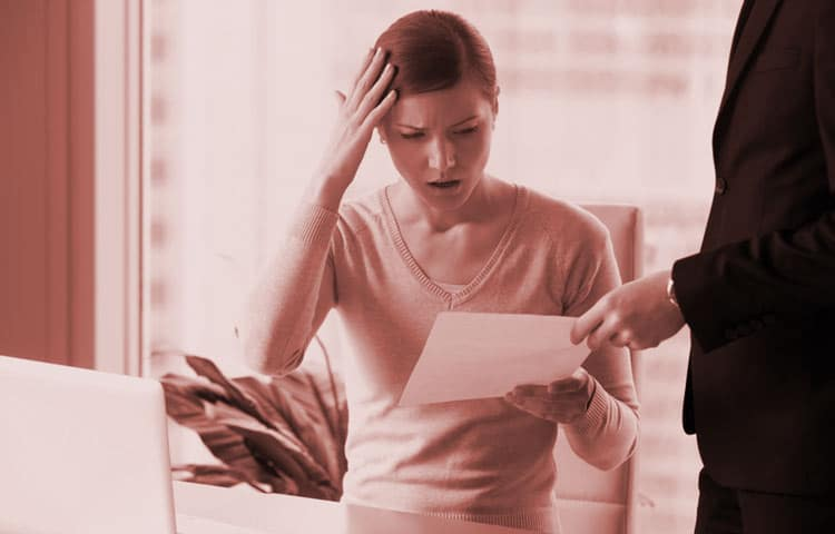 Woman-Looking-at-Legal-Letter-on-ADA-non-Compliance