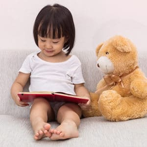 Uplevel-Medical-Practice-Through-Storytelling-Child-Reading-to-Teddy-Bear