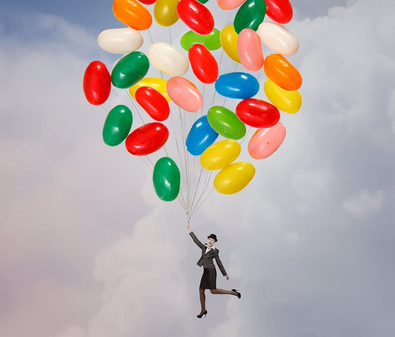 Woman-Floating-on-Jellybean-Balloons-SEO-Concept