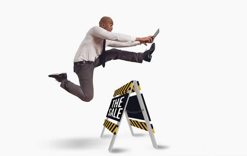 Businessman-Leaping-Over-Hurdle-with-Sales-Presentation