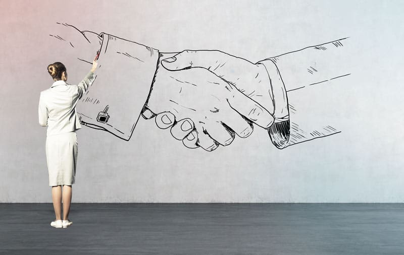 Sales-Presentations-That-Win-Business Businesswoman-Drawing-Handshake-on-Wall