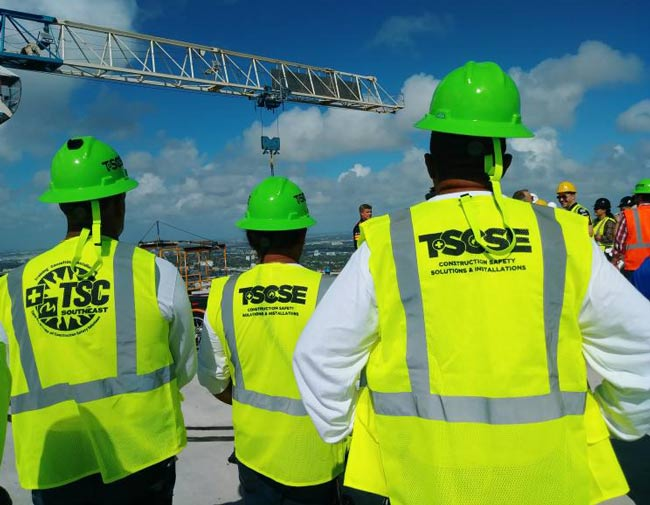 Total Safety logo design on Workers vests