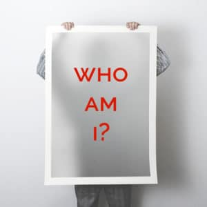Personal-Branding-Man-holding-Who-Am-I-Sign